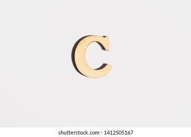 wooden letter C on white isolated background. ecologic letter concept