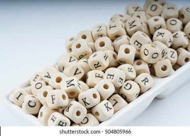 Wooden letter cube with white background