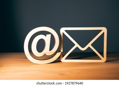 wooden letter with email sign on wooden background
