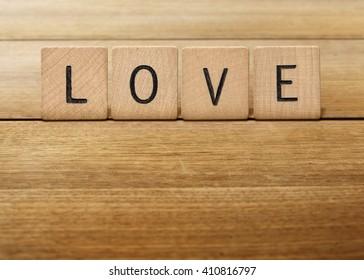 Wooden Letter tiles spelling love