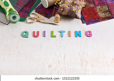 Wooden letters, consisting to the word quilting, accessories for quilting above the word, space for text