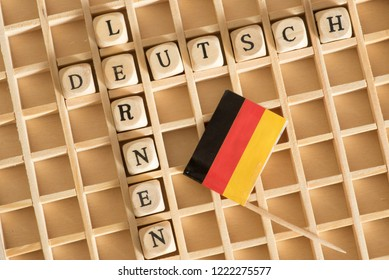 Wooden letters, crossword puzzles, german flag and german words for german and learning
