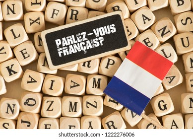 Wooden letters, flag of France and French translation for Do you speak French