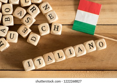 Wooden letters, flag of Italy and the Italian word for Italian