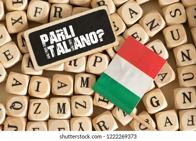 Wooden letters, flag of Italy and Italian translation for Do you speak Italian