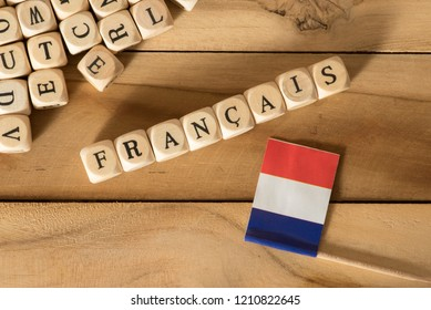 Wooden letters and the French word for French