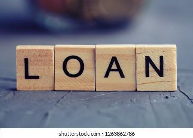 """Wooden letters """"loan"""". Loan concept."""