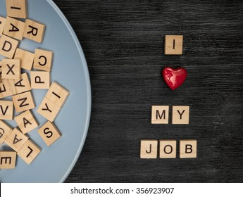 Wooden letters spelling I love my job