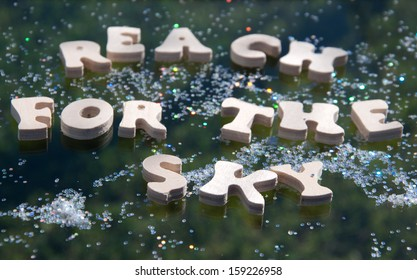 "wooden letters spelling out ""reach for the sky"" with glitter"