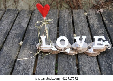 Wooden letters spelling out the word love, outdoor image.