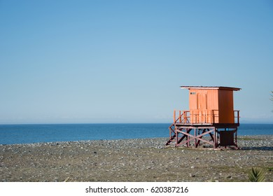 Wooden lifeguard hut on an empty beach