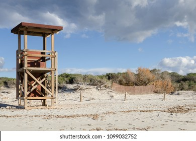 Wooden lifeguard tower at the sunny sand beach in Mallorca, Spain