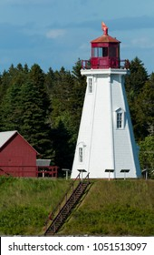 Wooden lighthouse tower on a warm summer day on Campobello Island, Canada.