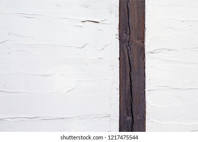 Wooden line divides in two different piece painted texture with brush and palette knife strokes. One part is smaller than the other.