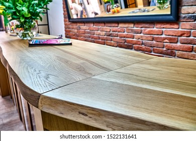 Wooden live edge table in solid oak. Solid oak countertop. Live edge counter top. Details furniture. Solid oak reception