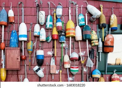 Wooden lobster fishing buoys hanging on the wall