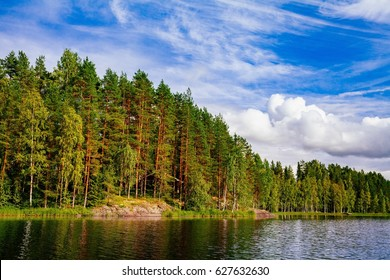 Wooden log cabin at the lake in summer in rural Finland