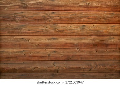 Wooden log cabin texture - interior design in traditional houses. Abstract background with horizontal lines and natural wood pattern with knots on a log wall. - Shutterstock ID 1721303947
