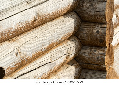 wooden log corner of the house. log wall. light wooden wall. environmentally friendly house. wooden blockhouse. wood fibers. logs. log cut. rustic wooden cabin. tree knots. hardwood. copy space