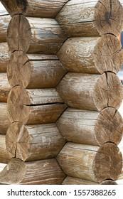 wooden log corner. log wall. light wooden wall. environmentally friendly house. wooden blockhouse. wood fibers. logs. log cut. rustic wooden cabin. tree knots. hardwood. copy space