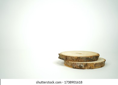 Wooden logs on the ground. Two logs on white background to add your mockups