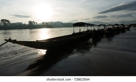 Wooden Long-tail speed boats stopped at the Chiang Khong pier in the morning, Mekong river, Chiang Rai, North of Thailand