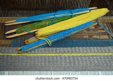 Wooden loom tools on a loom close up