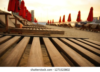 wooden lounger on the beach