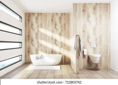 Wooden luxury bathroom interior with a white tub, a toilet, a gray towel and an originally shaped window. 3d rendering mock up