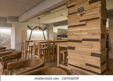 Wooden made furniture and decorations in hotel lobby bar interior