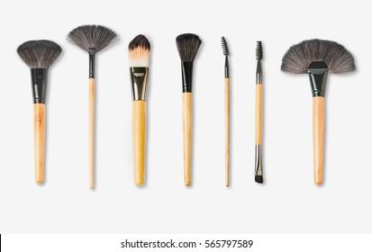 wooden make-up brushes isolated on white background