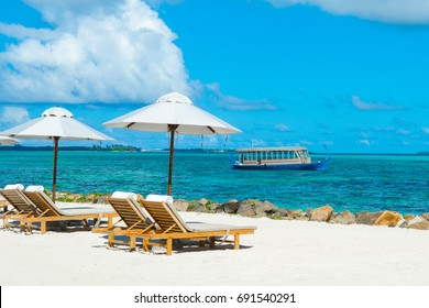 Wooden Maldivian traditional dhoni boat at sunny day on the turquoise Indian ocean water, Maldives