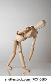 wooden man with backache