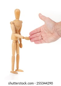 Wooden man figure shaking hands, isolated on white background