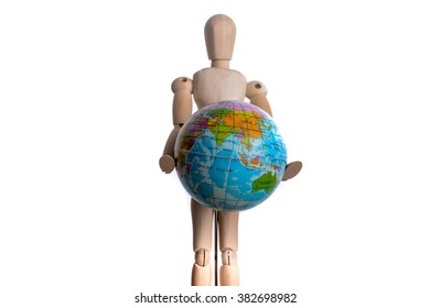 Wooden man holding a globe on a white background
