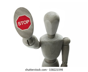 wooden man making a stop sign with his hand