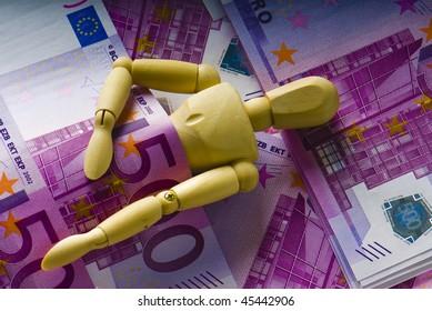 wooden man sleeps under a money