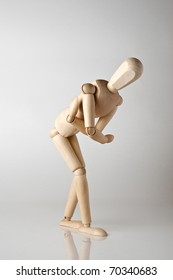 wooden man with stomach ache