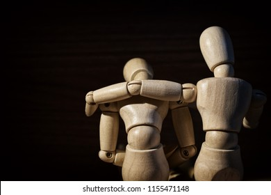 Wooden mannequin, Concern and worry of friend. Mental health, PTSD and suicide prevention. Post-traumatic stress disorder.