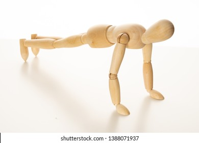 Wooden Mannequin Doing Push-Up Exercise
