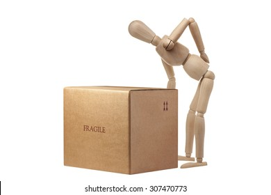 Wooden Mannequin having an accident carrying box isolated