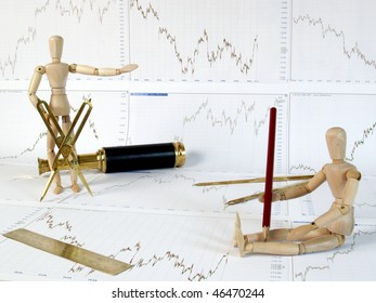 Wooden mannequin on exchange charts.