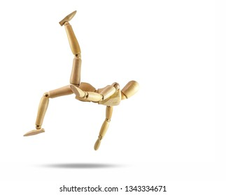 Wooden mannequin pretending to kick in the middle of the air on white background and clipping path.