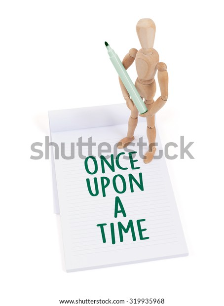 Wooden mannequin writing in a scrapbook - Once upon a time