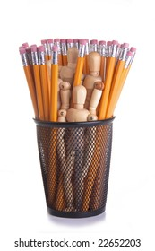 Wooden mannequins in a black metal pencil cup with many yellow pencils.  Conceptual image for office staff; workforce; secretarial; employment, etc.