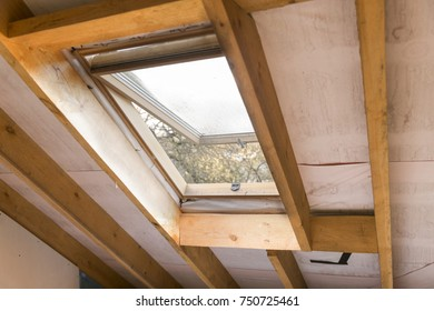 Wooden mansard or skylight window on attic. Attic renovation and insulation