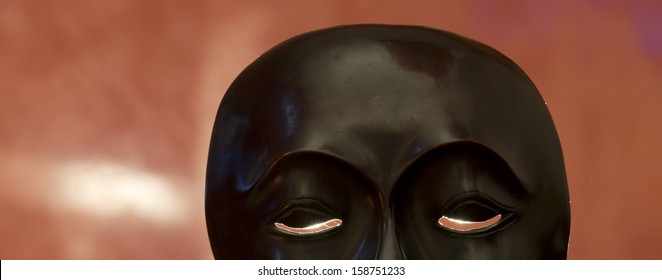 Wooden mask with red background