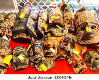 Wooden masks in the local market, Rarotonga, Aitutaki, Cook Islands. With selective focus