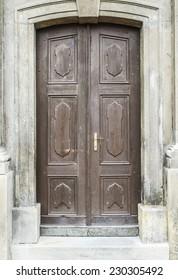 Wooden massive door in an ancient fortress Europe.