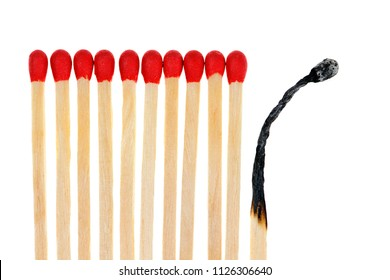 Wooden matches with one burned out isolated on white background